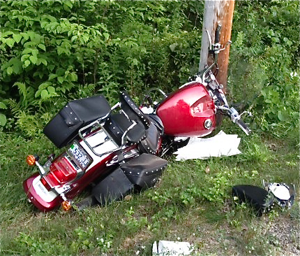 This photo provided by the York County Sheriff's Office shows the crash scene in Arundel where a 2008 Suzuki motorcycle operated by Shawn Biggar hit a utliity pole Wednesday evening.
