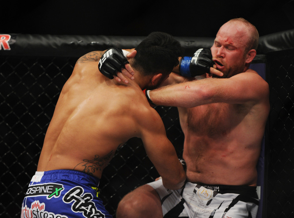Tim Boetsch, red gloves, and Brad Tavares, blue gloves, square off in a middleweight bout. Kevin Bennett/Special to the Telegram