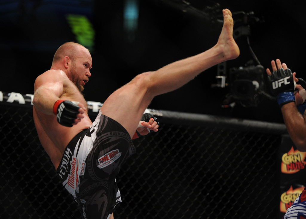 Tim Boetsch, red gloves, fights Brad Tavares, blue gloves, in a middleweight bout. Kevin Bennett/Special to the Telegram