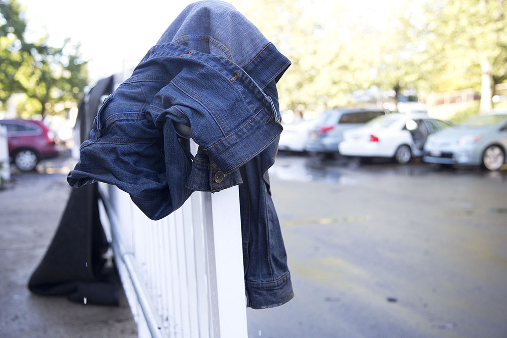 A jean jacket hung on the railing of the La Quinta Inns & Suites the day after heavy rains and flash flooding.