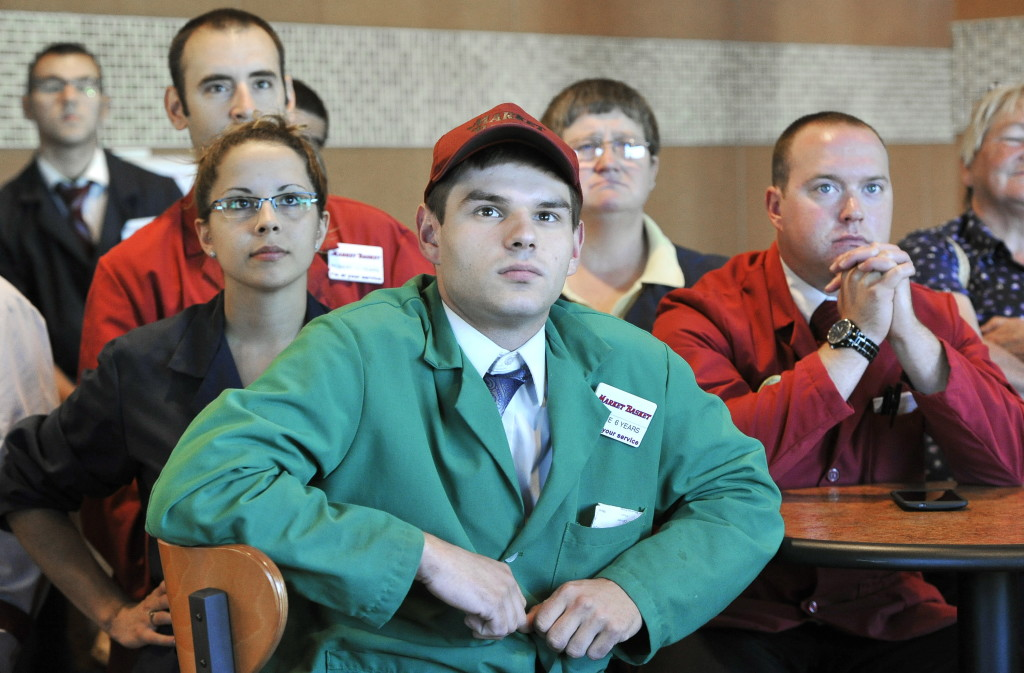 Shane Savage of Lebanon is among a roomful of employees waiting for a televised news conference by Arthur T. Demoulas at the Market Basket in Biddeford on Thursday.