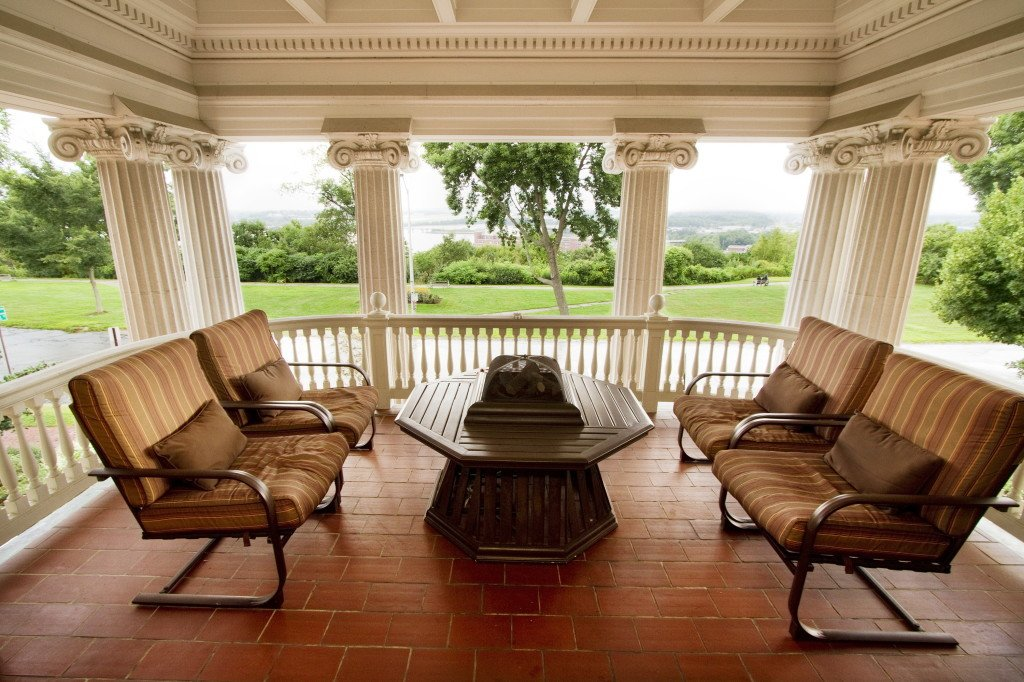 The second-floor porch of the West Mansion, looks over Portland's Western Promenade. The 13,000- square-foot residence. Carl D. Walsh / Staff Photographer