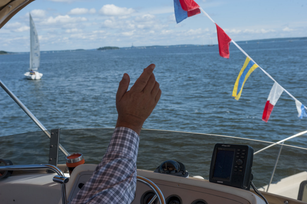 Captain David Gooch points out race boats before the MS Harborfest Regatta on Saturday. Photo by Logan Werlinger/Staff Photographer