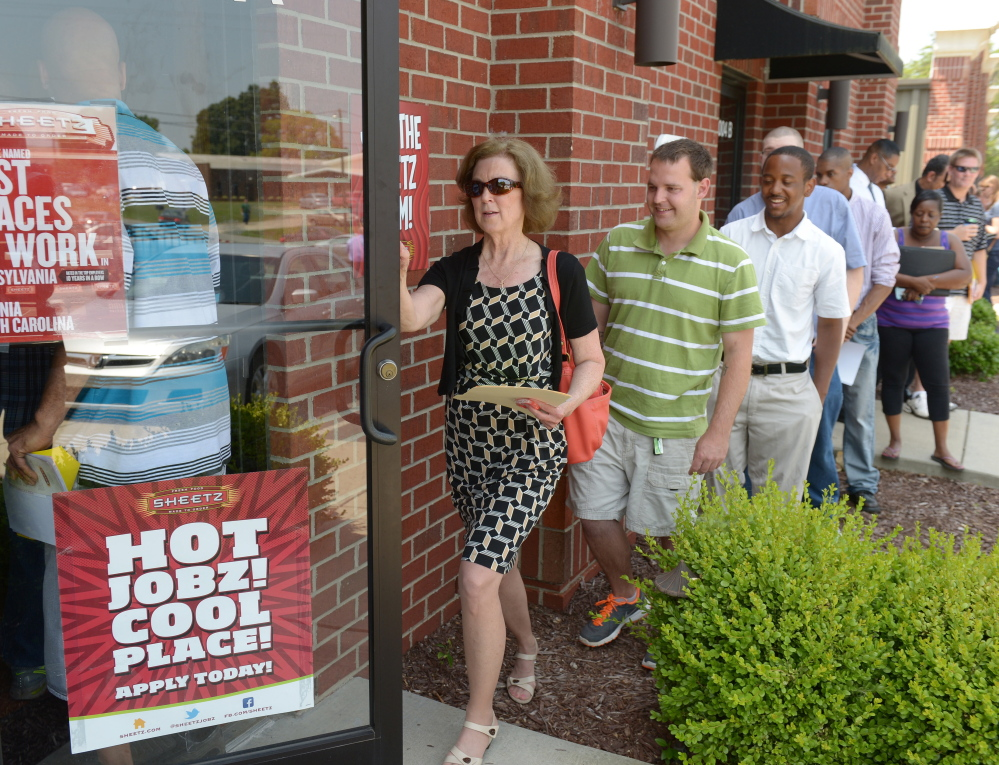 "Crowded job fairs are a common sight these days, like this one in Burlington, N.C. ""We don't have an economy that is as robust as we need it to be,"" said Christine Owens, executive director of the National Employment Law Project."