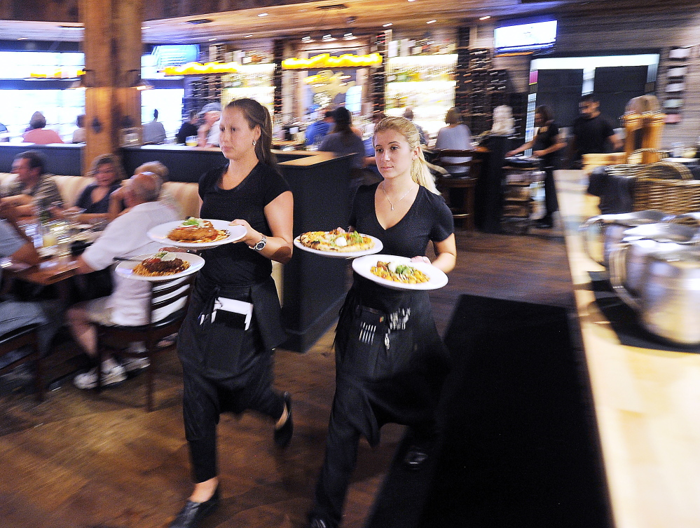 FREEPORT, ME - JULY 24: Food and atmosphere from Tuscan Grill in Freeport. Emily Martin, left, and Allie Gagne deliver the food orders pronto to patrons. (Gordon Chibroski/Staff Photographer)