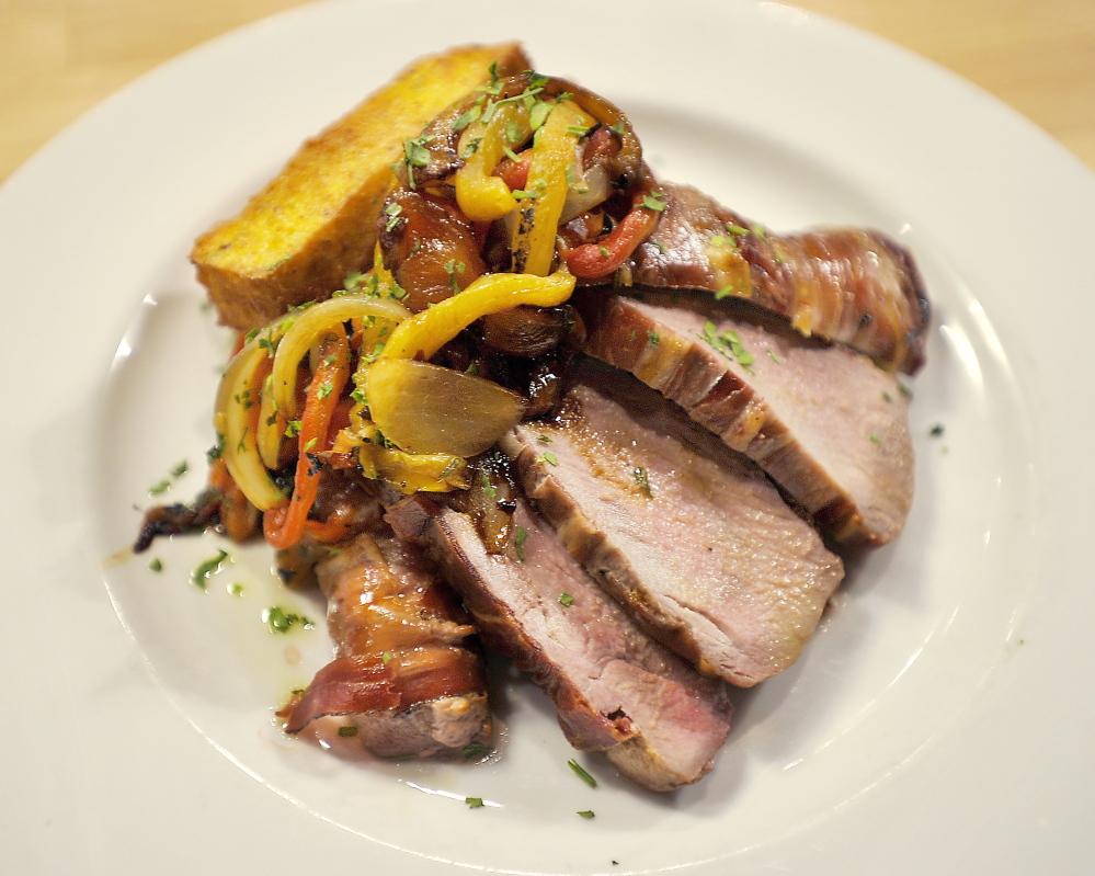 "Pork tenderloin at the Tuscan Bistro: ""Still quivering."""