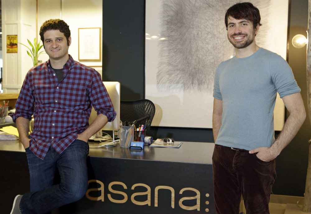 """Asana co-founders Dustin Moskovitz, left, and Justin Rosenstein are shown at the company's headquarters in San Francisco. """"We are trying to make all the soul-sucking work that comes with email go away,"""" Rosenstein says."""