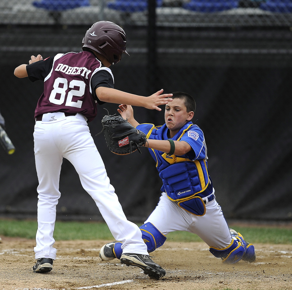 Falmouth's Francis Kiely tags out New Hampshire's Bobby Doherty at home plate during Falmouth's 3-1 win at Breen Field in Bristol, Connecticut on Friday.