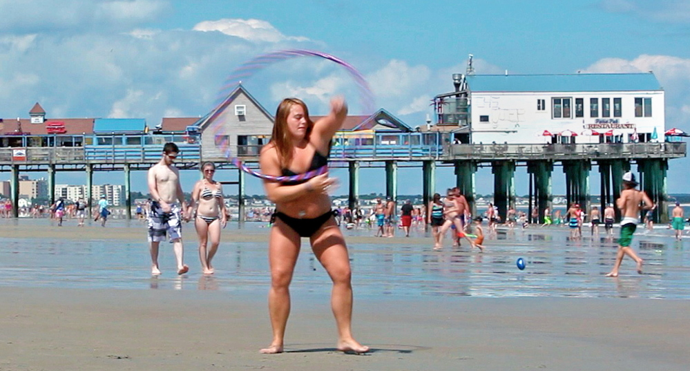 Nicole Raulukaitis practices dancing with a hoop. The Pier has stood as an iconic image of the town for more than 100 years. Amelia Kunhardt/Staff Photographer