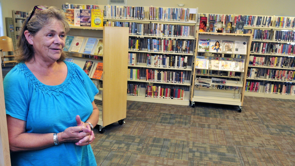 Librarian Donna McClusky is shown in Umberhine Public Library  in Richmond.