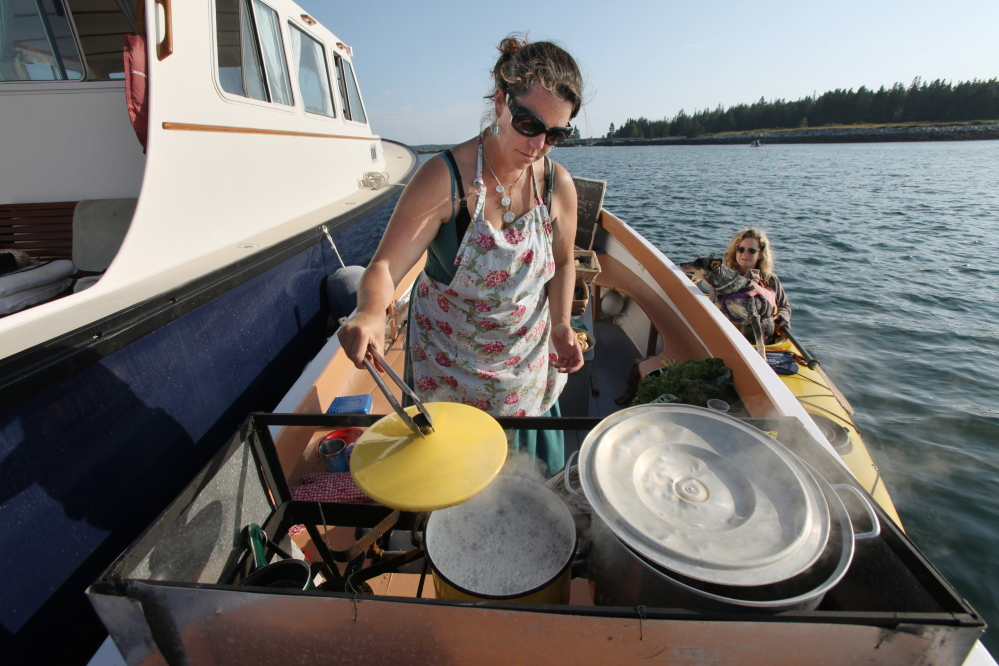 ANDREWS ISLAND, ME Ð JULY 26: A tote of clams is seen Saturday, July 26, 2014 on Andrews Island, Maine. (Photo by Joel Page/Staff Photographer)