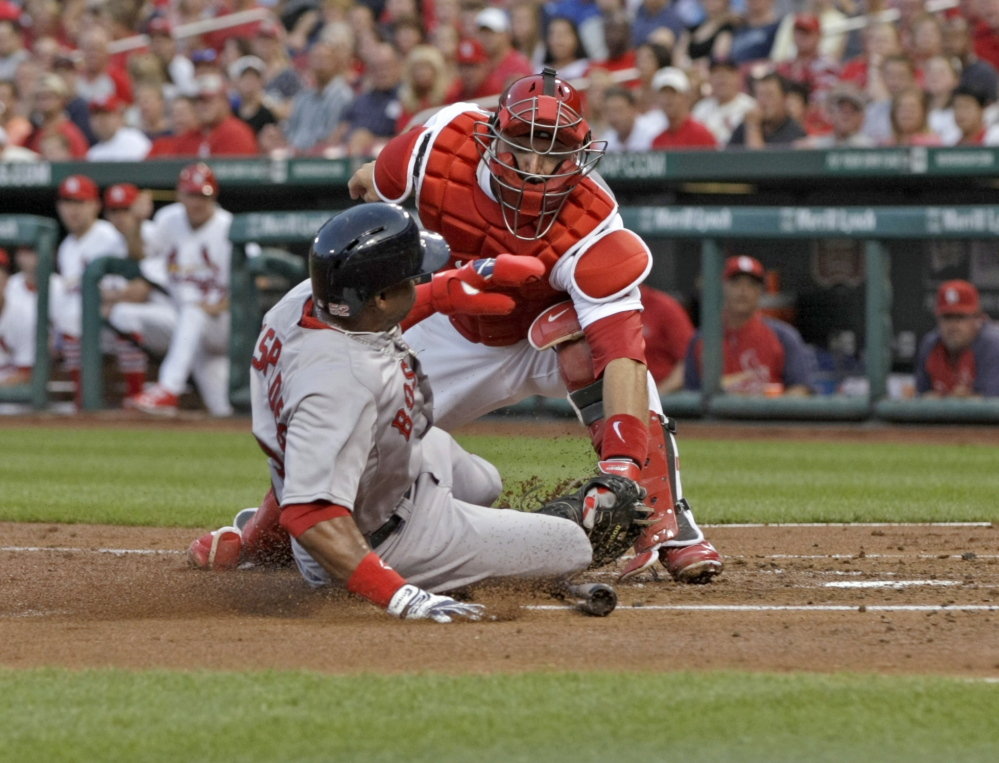 Catcher A.J. Pierzynski, remember him, tags out Boston's Yoenis Cespedes, who tried to score from third on a grounder in the second inning Tuesday. The Cardinals beat the Red Sox 3-2 by scoring a run in the bottom of the eighth in a rematch of last year's World Series.
