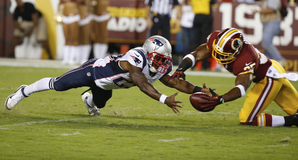 New England Patriots running back Roy Finch and Washington defensive back Akeem Davis chase a loose ball in the second half of their preseason game in Landover, Md., on Thursday.