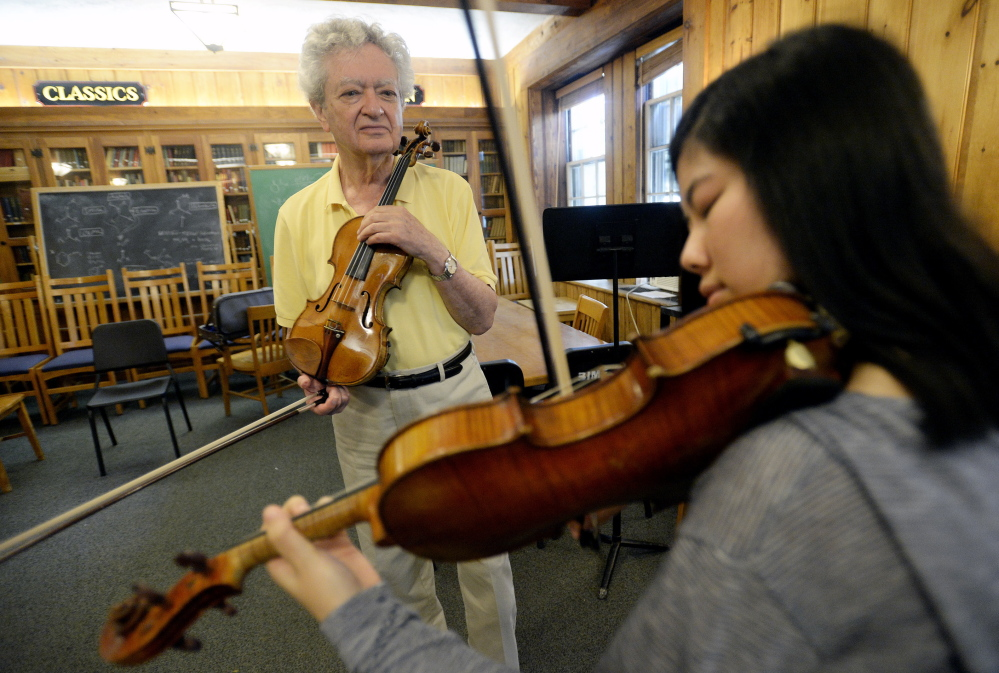 Lewis Kaplan watches Muyun Tang of China as she plays the violin during a lesson at Bowdoin College.  Shawn Patrick Ouellette/Staff Photographer