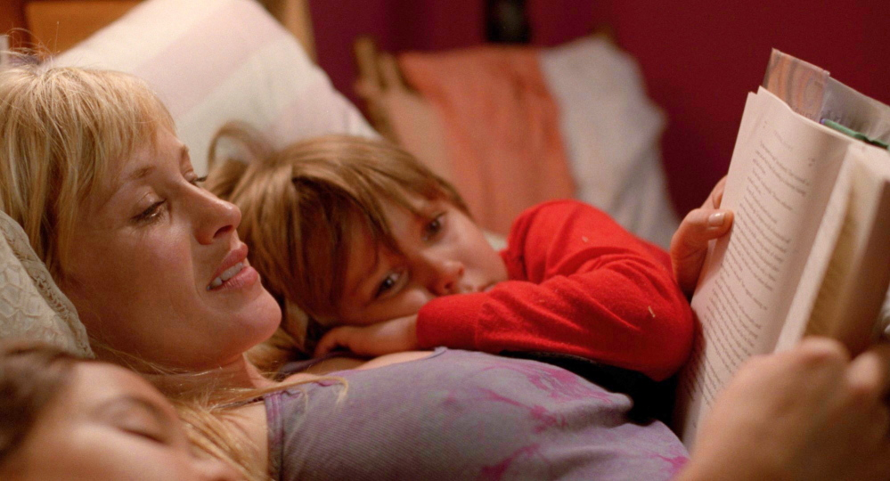 """Patricia Arquette, as Mom, reads to her children, played by Ellar Coltrane and Lorelei Linklater, in """"Boyhood."""" """"I always knew I was working on something beautiful"""" she says about working on the film over the course of 12 years."""
