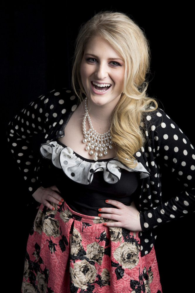 """Singer-songwriter Meghan Trainor, known for the pop single """"All About That Bass,"""" poses for a photo Thursday in New York."""