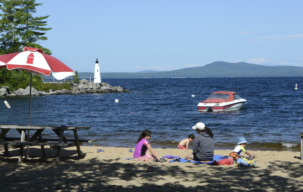 With its 6-foot lighthouse, flower beds and mountain views, Beach 6 just might be the most popular swimming and sunbathing area on Frye Island.