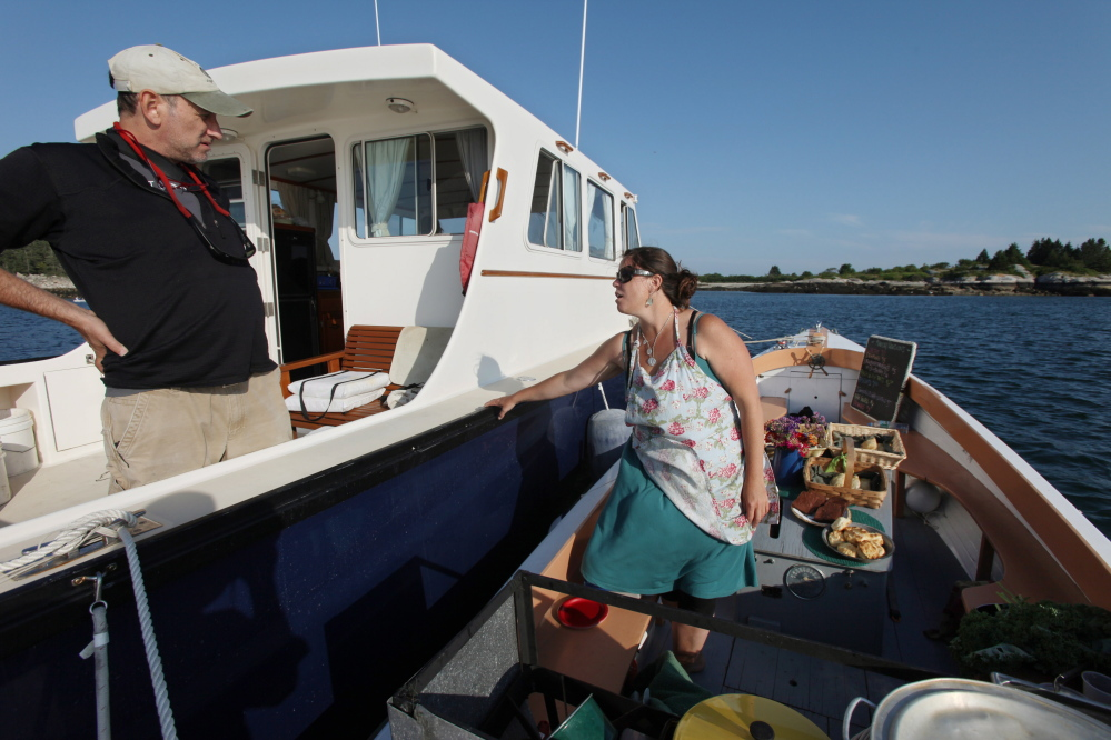 Reilly Harvey is back in business selling lobster dinners and baked goods to boaters in Penobscot Bay. Joel Page/Staff Photographer