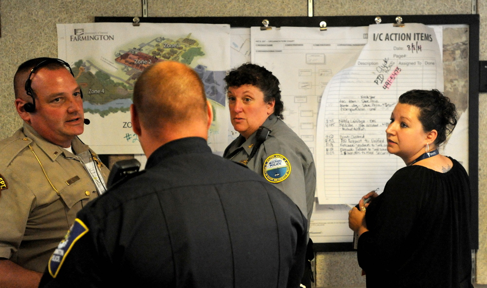 Wilton Police Chief Heidi Wilcox, facing center, acts as the incident commander from the Farmington Fire Department during a Homeland Security drill in Farmington on Friday.