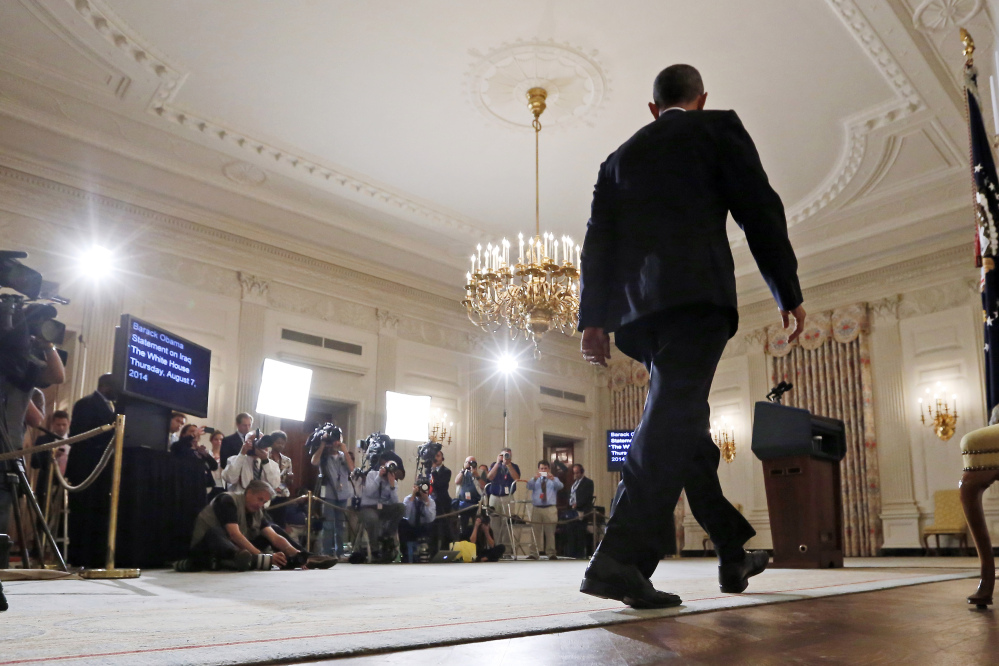 President Barack Obama approaches the podium to speak about the situation in Iraq in the State Dining Room at the White House in Washington.