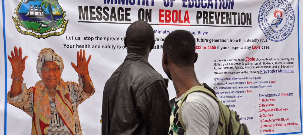The image of Liberia President Ellen Johnson Sirleaf, left, appears on a public information banner warning people about the Ebola virus in the city of Monrovia, Liberia.