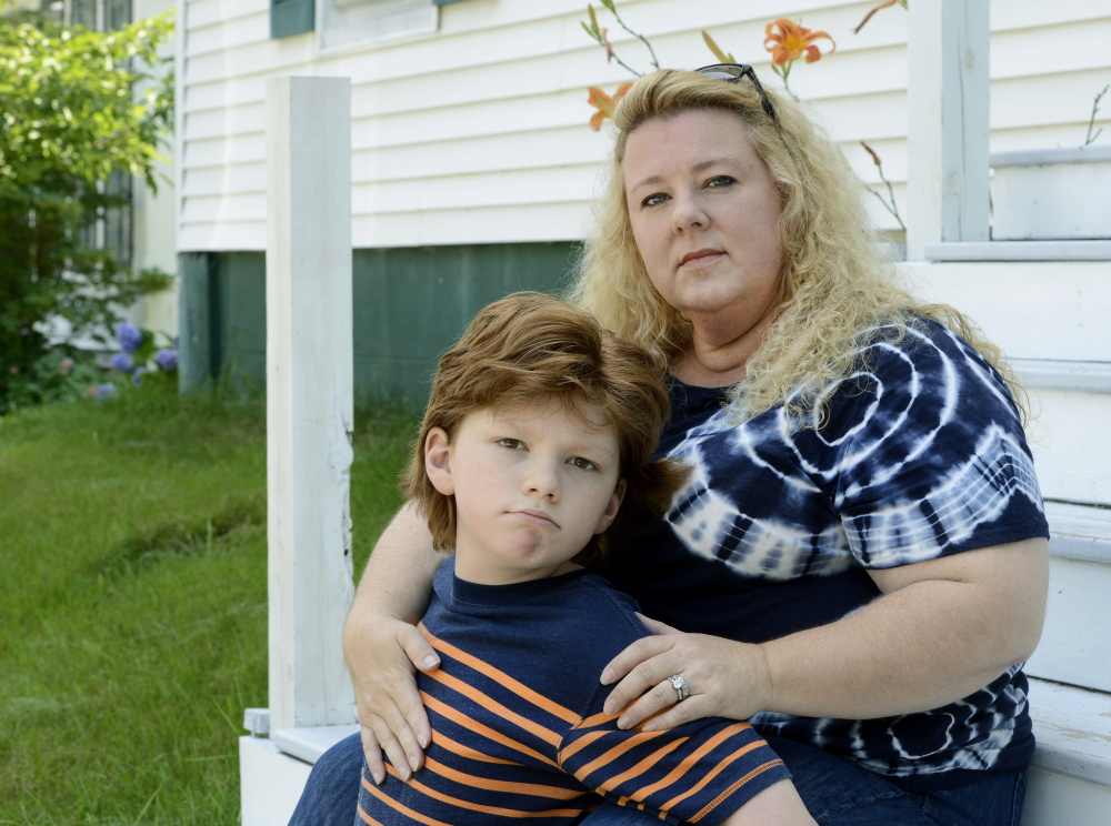 """Ginger Taylor, an anti-vaccine advocate from Brunswick, describes her autistic son Chandler, now 12, as """"a vaccine-injured child."""""""