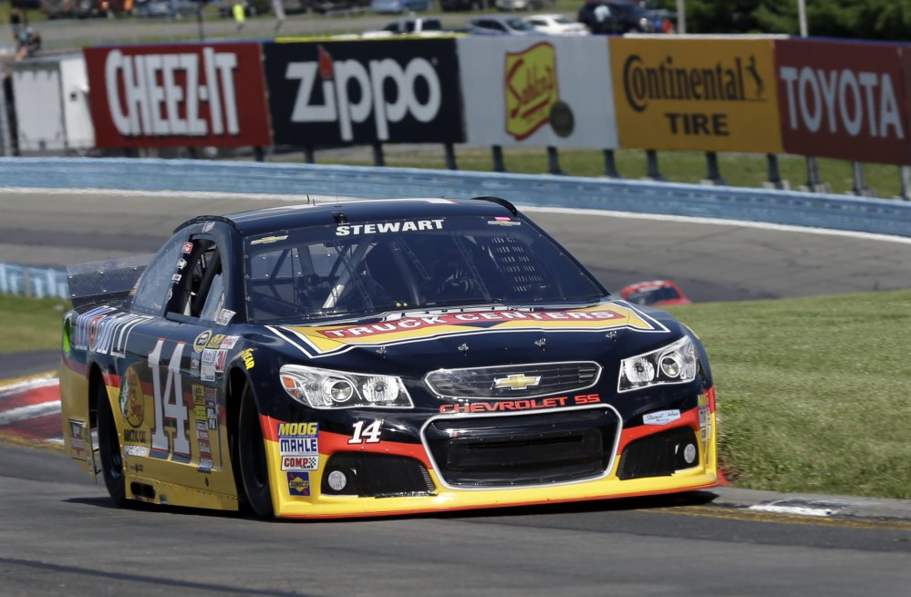 Tony Stewart (14) drives through the s-turns during a qualifying session for Sunday's NASCAR Sprint Cup Series auto race at Watkins Glen International, Saturday, in Watkins Glen N.Y.