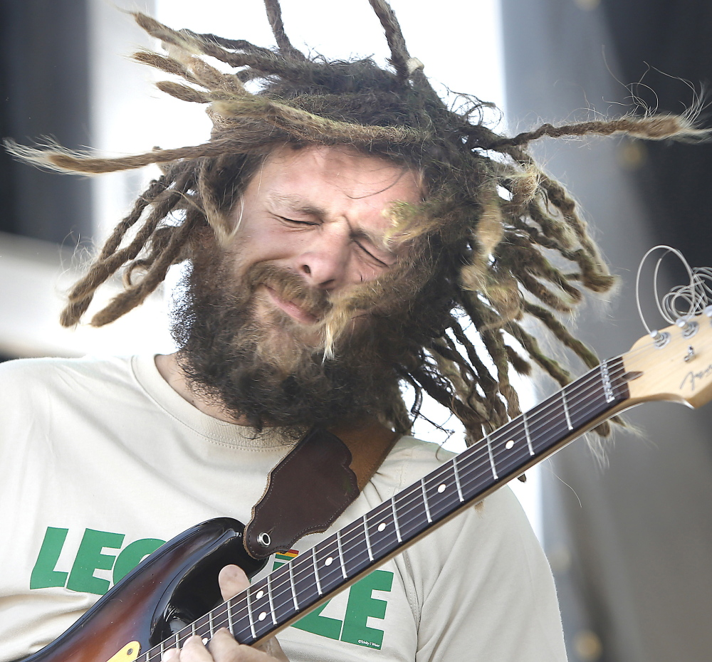 Jay Harris, lead guitarist with Soul Rebel Project, entertains the crowd during the first Portland Reggae Fest at the Maine State Pier on Sunday.