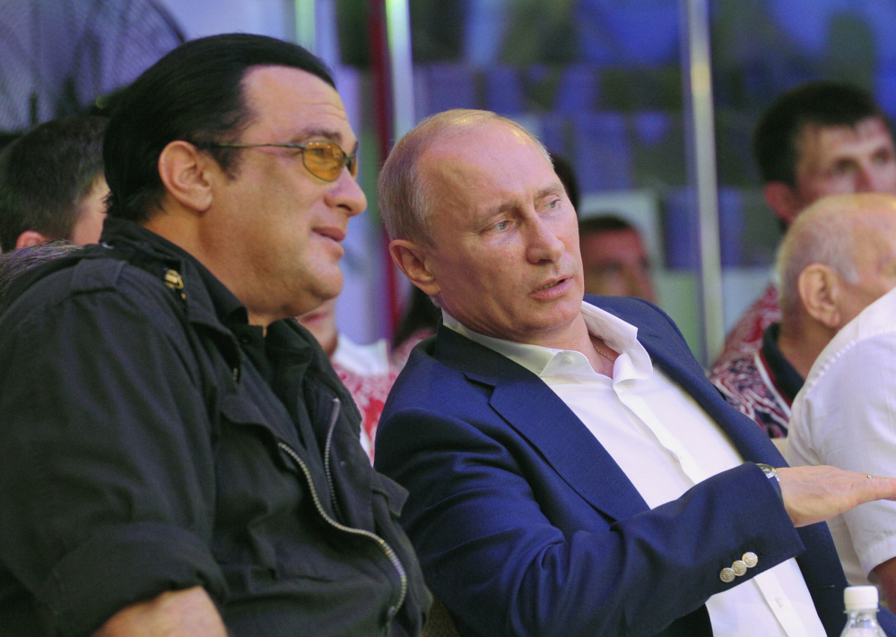 Actor Steven Seagal, left, and Russian President Vladimir Putin watch a mixed martial arts championship in the Black Sea resort of Sochi, Russia, in August 2012. Seagal reportedly performed Saturday at a concert in the breakaway region of Crimea on a stage decorated with the flag of pro-Russian separatists fighting in eastern Ukraine.