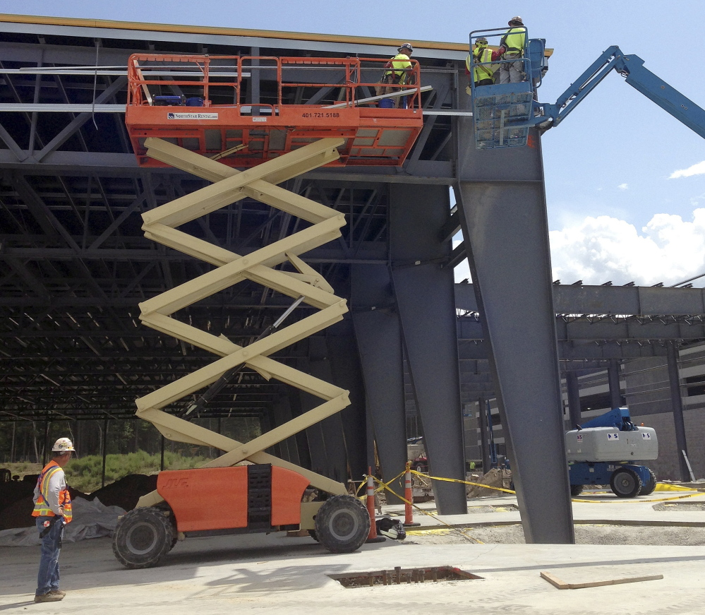 Construction continues on a $225 million project by Penn National Gaming to transform the Plainridge harness racing track into a slot parlor in Plainville, Mass.