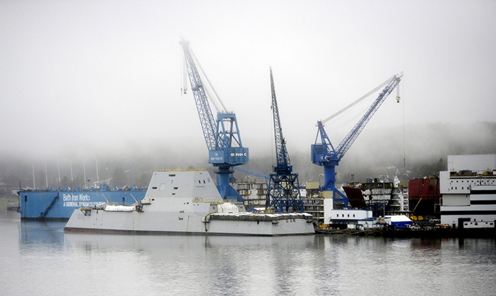 This May 1, 2014, photo shows the Navy destroyer USS Zumwalt under construction at Bath Iron Works. General Dynamics, the shipyard's owner, saw its share price set a record on Sept. 19, fueled by surging demand for military weapons and equipment. Shawn Patrick Ouellette / Staff Photographer