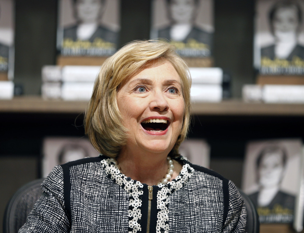 "Former Secretary of State Hillary Rodham Clinton, seen greeting a customer during a book signing of her new book, ""Hard Choices,"" on July 29 in Saratoga Springs, N.Y., has made her most aggressive effort yet to distinguish herself from her former boss, rebuking President Obama for his cautious approach to global crises."