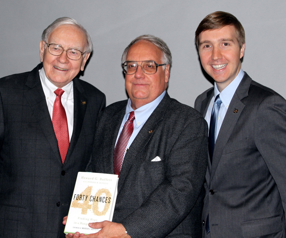 Warren Buffett, left, is giving most of his billions to charity rather than his son Howard G. Buffett, center, standing with his son Howard W. Buffett.