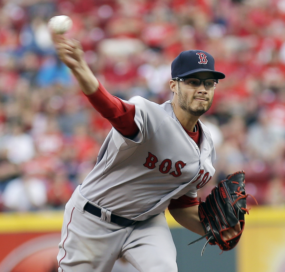 Red Sox pitcher Joe Kelly throws in the first inning Tuesday night against the Cincinnati Reds. After a shaky start, Kelly finished allowing just five hits and two runs in six innings.