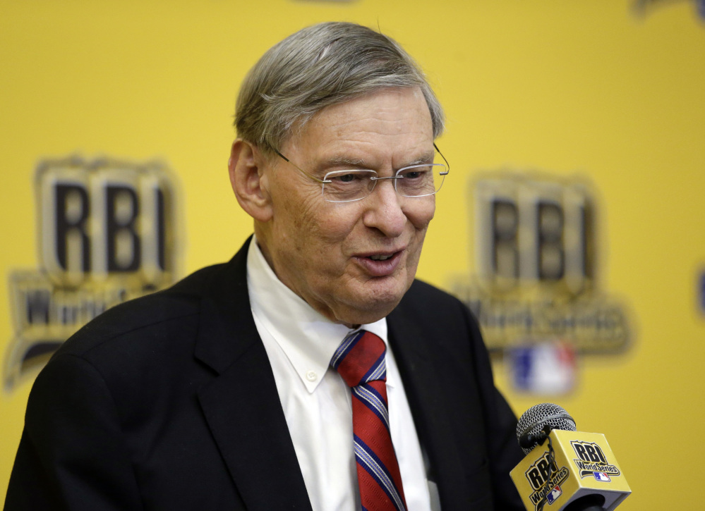 """The Associated Press Baseball Commissioner Allan H. """"Bud"""" Selig smiles as he responds to a question from reporters after addressing participants of the 2014 Reviving Baseball in Inner Cities World Series during a luncheon, Aug. 6, 2014, in Grapevine, Texas."""