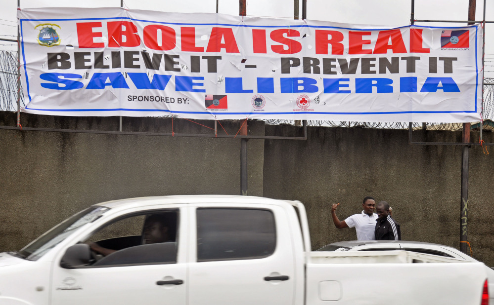 In this image taken Saturday, a  banner  adorns a street as the deadly Ebola virus spread in Monrovia, Liberia.
