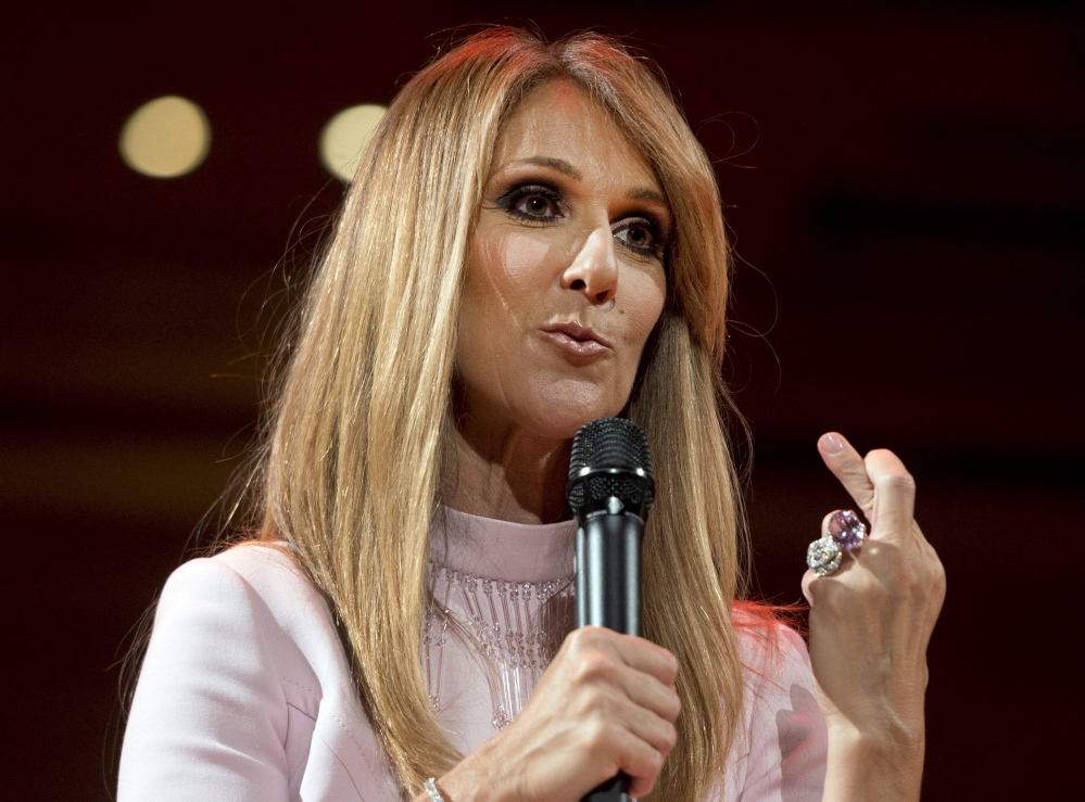 Celine Dion crosses her fingers as she speaks about her husband's recovery from a cancerous tumor.