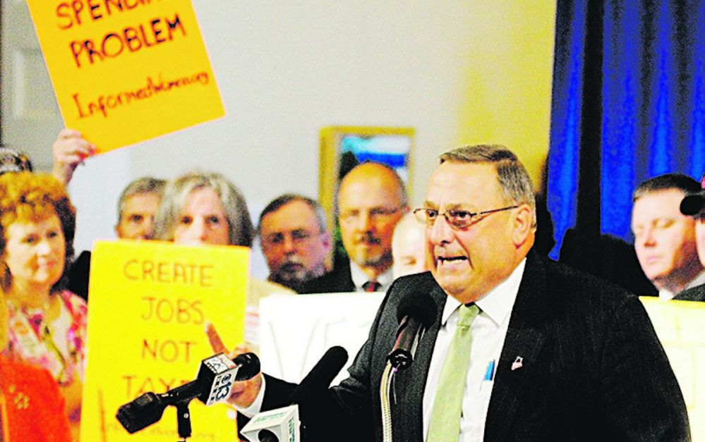 Gov. Paul LePage speaks during a rally last year in the Hall of Flags at the State House in Augusta.