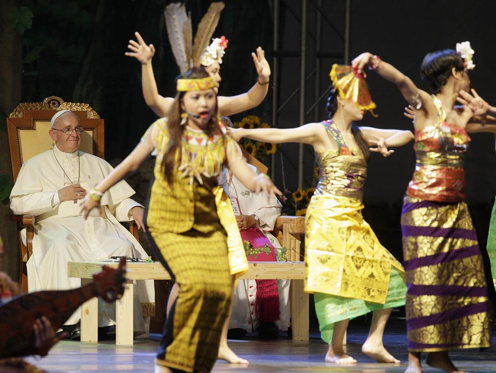 Young dancers perform at the Solmoe Sanctuary in Dangjin, South Korea.