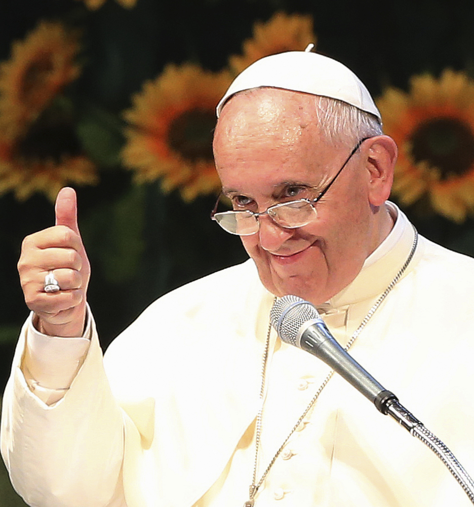 Pope Francis gives the thumbs up Friday while watching a performance by young dancers at the Solmoe Sanctuary in Dangjin, South Korea.