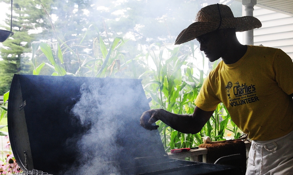 Craig Hickman prepares a smoker Thursday at his home in Winthrop. He and other volunteers were getting ready for the third annual Family Barbecue & Gumbo Festival to End Hunger on Saturday afternoon in Winthrop.