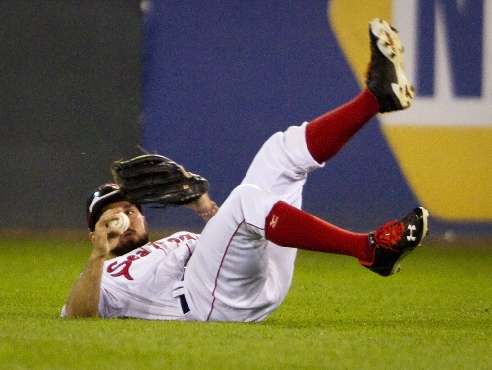 Sea Dogs right fielder Kevin Heller rolls to his feet after missing a diving catch against the Richmond Flying Squirrels at Hadlock Field in Portland. Carl D. Walsh/Staff Photographer