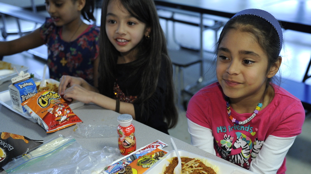 Children eat lunch at Patrick Henry Elementary in Alexandria, Va. Programs that offer Maine kids food outside the normal school day are underutilized.