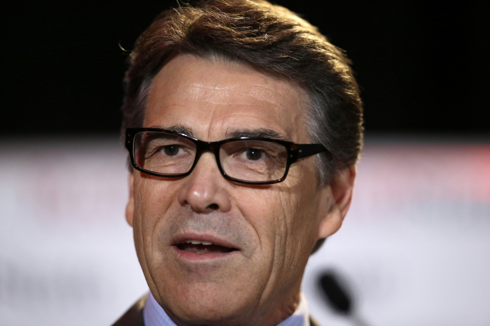 Texas Gov. Rick Perry, who was indicted for abuse of power after carrying out a threat to veto funding for state public corruption prosecutors, says he will fight those indictments.