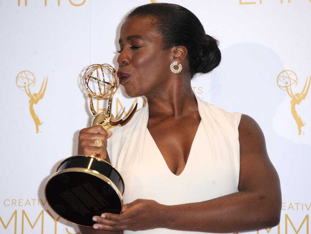 """Uzo Aduba kisses her Emmy for her role in """"Orange is the New Black"""" in Los Angeles on Saturday."""