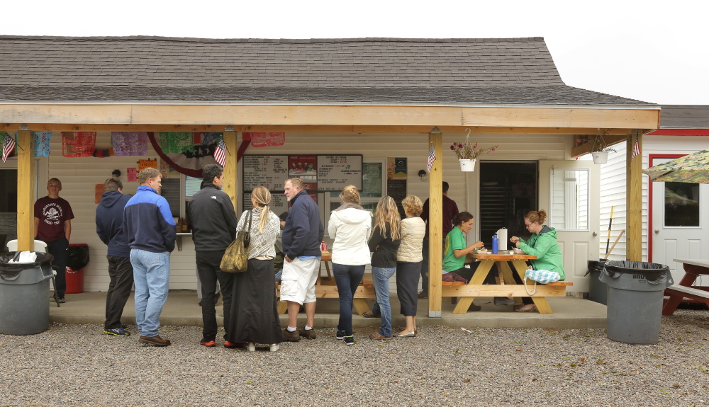 Customers queue up at the eatery, which opened in May and already has gained a loyal following of locals and tourists. Burritos go for $4.75, about half the price they do in Portland.