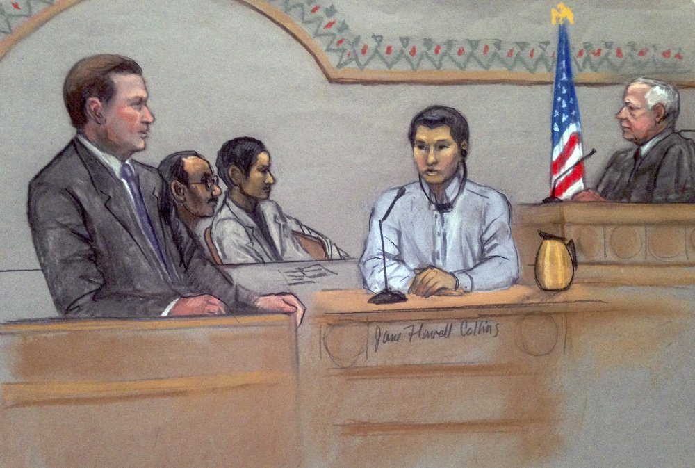 In this courtroom sketch, Dias Kadyrbayev, center, testifies in federal court in June 2 in Boston. Kadyrbayev is accused of removing items from marathon bombing suspect Dzhokhar Tsarnaev's dorm room several days after the 2013 bombings.