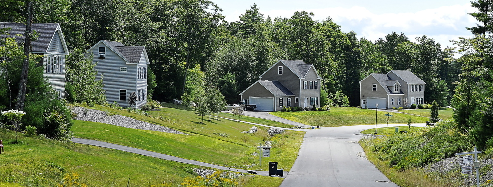 Homes stand on winding Thrush Terrace in Windham. Buyers can get more house for their money here than in nearby towns and the demand for larger houses is growing.