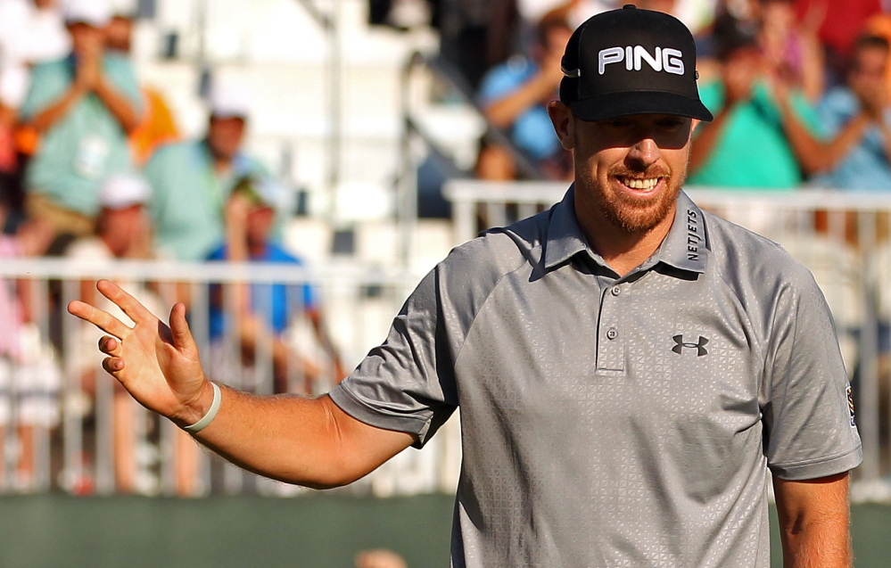 Hunter Mahan celebrates after putting on the 18th green on his way to victory at The Barclays on Sunday in Paramus, New Jersey. Mahan shot 6-under par Sunday to win for the first time in 49 events.