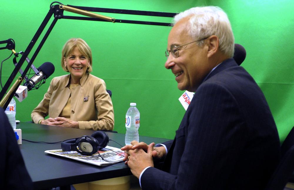 Democratic gubernatorial candidate Donald Berwick smiles as Martha Coakley looks on during a debate Monday.